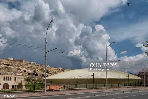 museum of mosaics and caves at the background in şanlıurfa. - emreturanphoto stock pictures, royalty-free photos & images