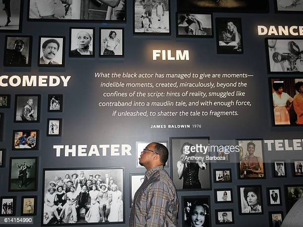A museum patron stands in front of 'Film' display at the National Museum of African American History and Culture Washington DC September 28 2016