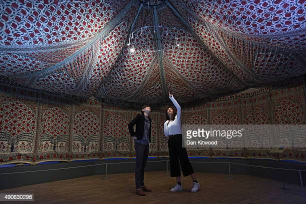 Museum staff look inside 'Tipu's Tent' during the press preview of 'The Fabric of India' at the Victoria and Albert Museum on September 30 2015 in...