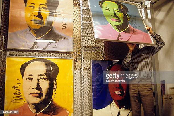 A museum staff member conducting a routine check of Andy Warhol's works of Chairman Mao Tse Tung in the cellar of the Museum of Contemporary Art in...