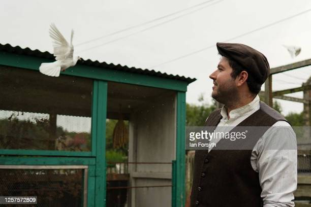Museum staff member David Watchman checks the doves in a colliery cottage garden at Beamish Museum as it prepares to re-open to the public on July...