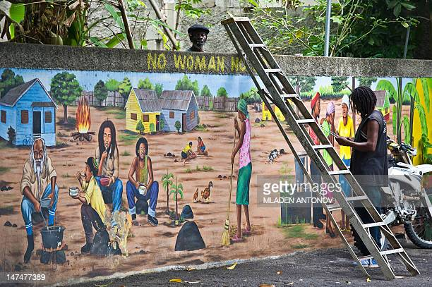 Museum staff works on a mural of Jamaican Reggae legend Bob Marley his museum in Kingston on June 30 2012 Jamaica will celebrate its 50th anniversary...