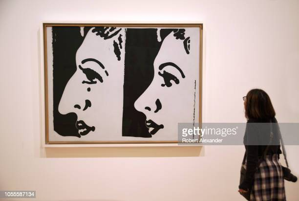 SAN FRANCISCO CALIFORNIA SEPTEMBER 16 2018 A museum visitor admires a 1961 painting titled 'Before and After' by Andy Warhol at the San Francisco...
