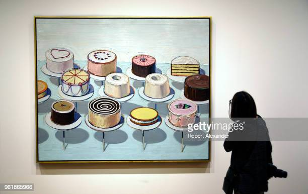 A museum visitor admires a 1963 painting by Wayne Thiebaud titled 'Cakes' at the National Gallery of Art East Building on the National Mall in...