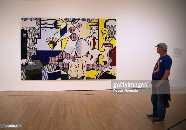 SAN FRANCISCO CALIFORNIA SEPTEMBER 16 2018 A museum visitor admires a 1978 painting titled 'Figures with Sunset' by Roy Lichtenstein at the San...