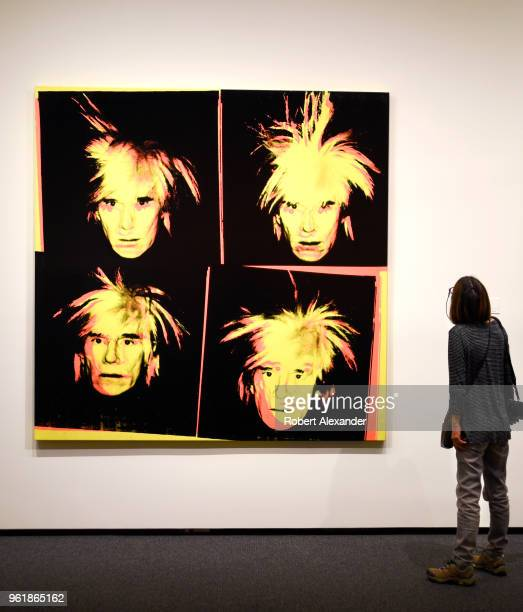 A museum visitor admires a 1986 selfportrait painting by Andy Warhol at the National Gallery of Art East Building on the National Mall in Washington...