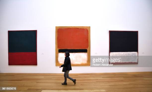 A museum visitor walks past paintings by Mark Rothko at the National Gallery of Art East Building on the National Mall in Washington DC