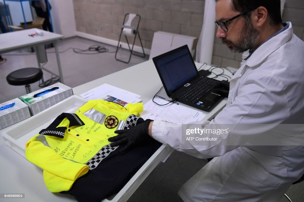 A museum worker catalogues a uniform of the Barcelona local police
