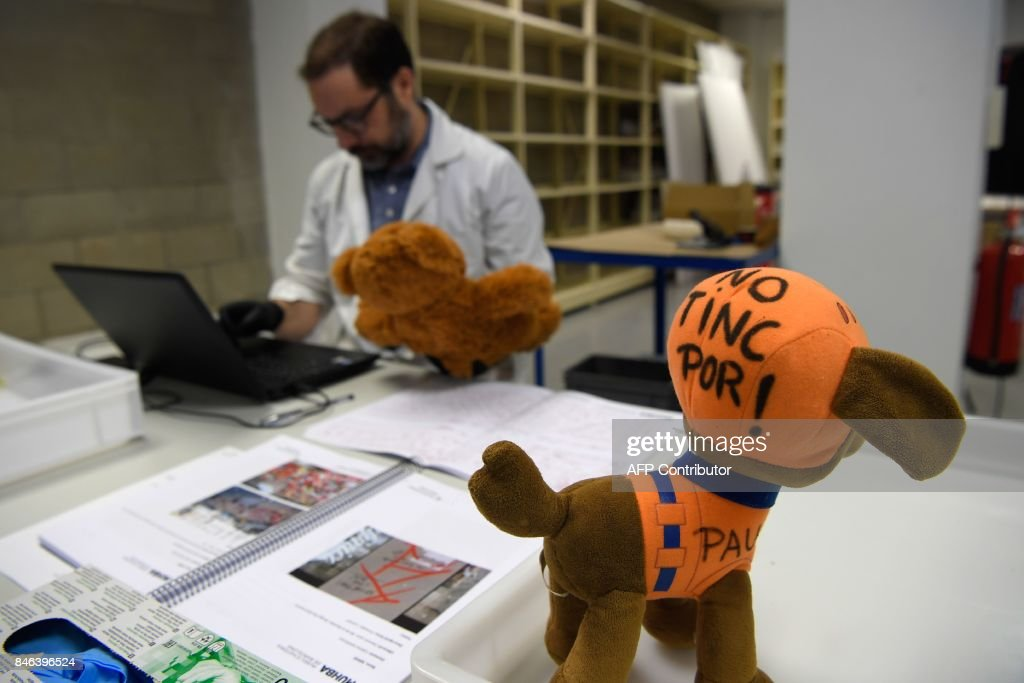 A museum worker catalogues toys collected at Las Ramblas makeshift memorial, set up following the August, 17 Barcelona jihadist attack, and stored to be catalogued and preserved at the Museu D'Historia de Barcelona (MUHBA) on September 13, 2017 in Barcelona. /