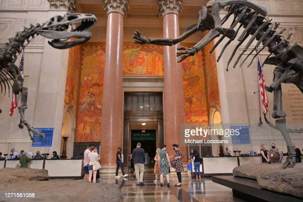 Museumgoers enter the American Museum of Natural History via the Theodore Roosevelt Rotunda on the day of its reopening on September 09, 2020 in New...
