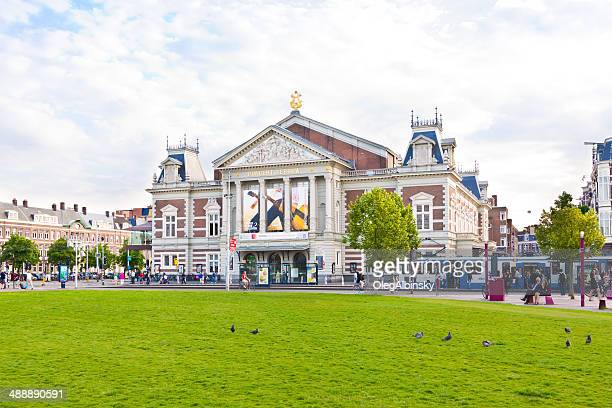 museumplein and royal concertgebouw, amsterdam. - concert hall stock pictures, royalty-free photos & images