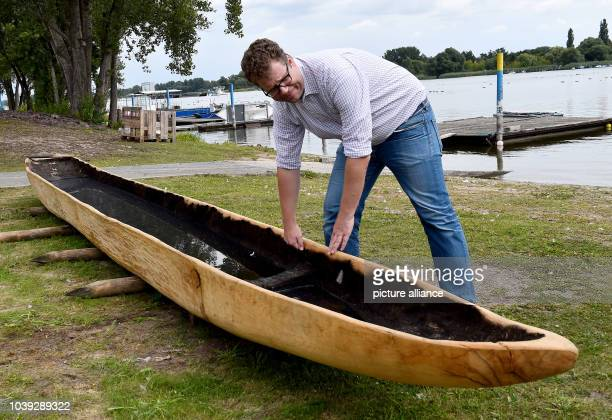 Museums director Rainer Kossian checks the replica of the Slavs temporal dugout of Ziesar on the bank of Beetzsees in Brandenburg Germany 18 August...