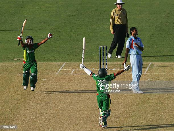 Mushfiqur Rahim and Mohammad Ashraful of Bangladesh celebrate beating India at the end of the ICC Cricket World Cup 2007 Group B match between...