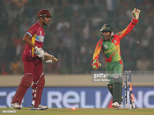 Mushfiqur Rahim of Bangladesh celebrates as he stumps Lendl Simmons of the West Indies during the ICC World Twenty20 Bangladesh 2014 match between...
