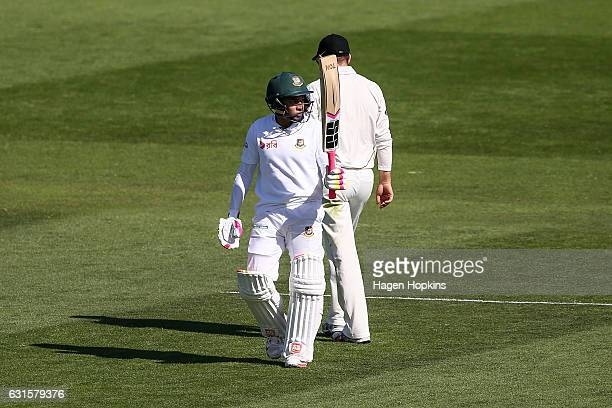 Mushfiqur Rahim of Bangladesh celebrates his 150 with teammate Shakib Al Hasan during day two of the First Test match between New Zealand and...