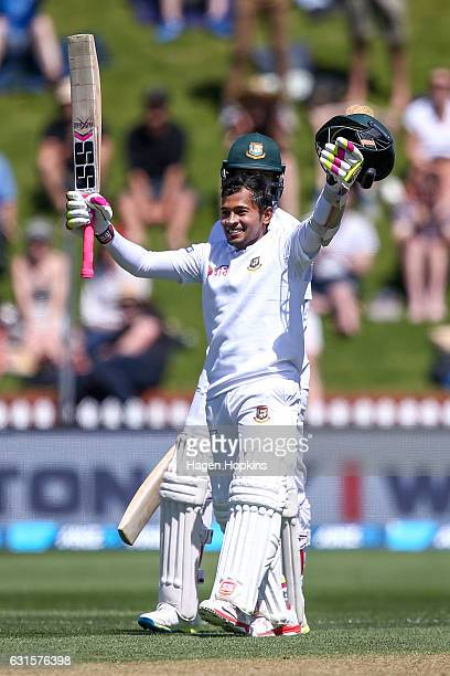 Mushfiqur Rahim of Bangladesh celebrates his century with teammate Shakib Al Hasan during day two of the First Test match between New Zealand and...