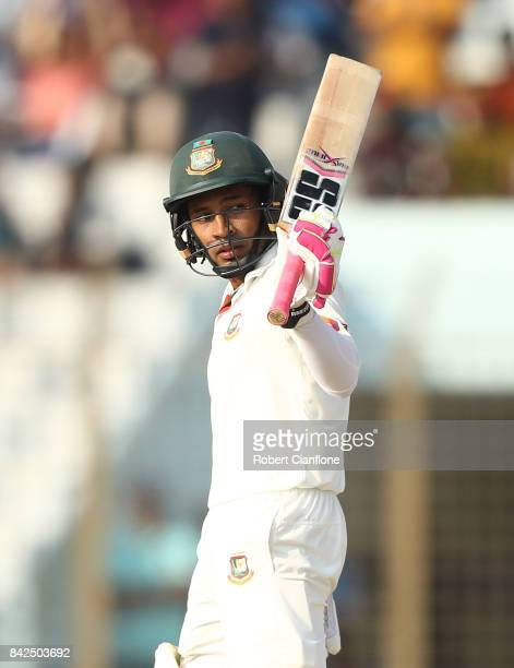 Mushfiqur Rahim of Bangladesh celebrates making his half century during day one of the Second Test match between Bangladesh and Australia at Zahur...