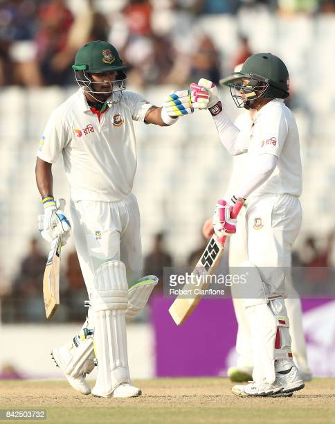 Mushfiqur Rahim of Bangladesh celebrates making his half century with Shabbir Rahman Roman during day one of the Second Test match between Bangladesh...