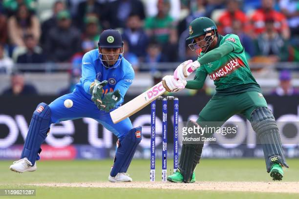 Mushfiqur Rahim of Bangladesh cuts to the offside as India wicketkeeper MS Dhoni looks on during the Group Stage match of the ICC Cricket World Cup...