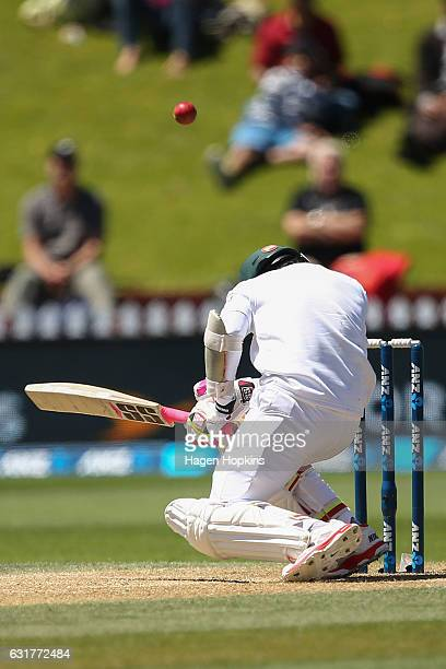 Mushfiqur Rahim of Bangladesh goes to ground after being struck in the helmet by a delivery from Tim Southee of New Zealand during day five of the...
