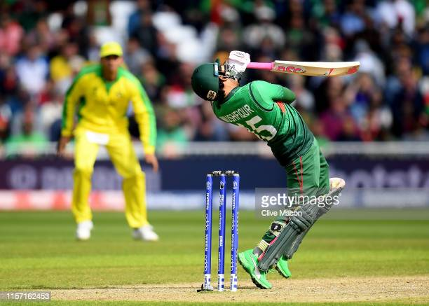 Mushfiqur Rahim of Bangladesh in action batting as Alex Carey of Australia looks on during the Group Stage match of the ICC Cricket World Cup 2019...