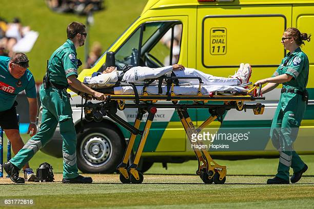 Mushfiqur Rahim of Bangladesh is stretchered into an ambulance after being struck in the helmet by a delivery from Tim Southee of New Zealand during...