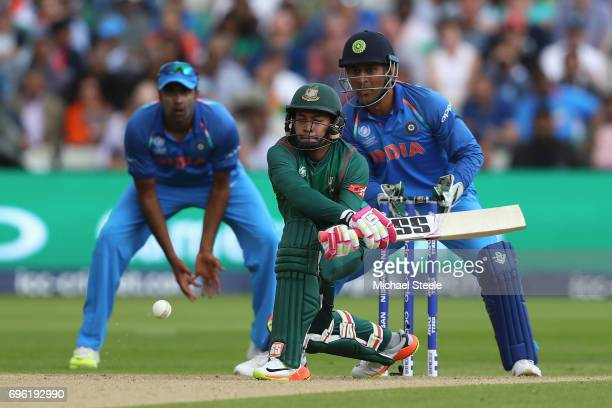 Mushfiqur Rahim of Bangladesh reverse sweeps as wicketkeeper MS Dhoni looks on during the ICC Champions Trophy SemiFinal match between Bangladesh and...