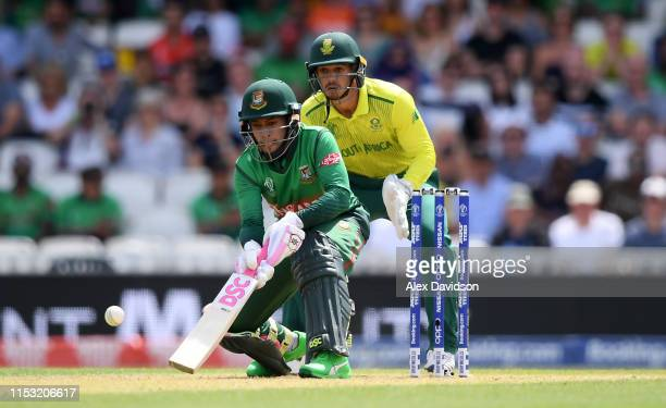 Mushfiqur Rahim of Bangladesh scoops watched on by Quinton De Kock of South Africa during the Group Stage match of the ICC Cricket World Cup 2019...