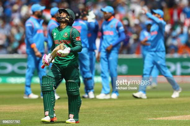 Mushfiqur Rahim of Bangladesh shows his frustration after being caught by Virat Kohli of India off the bowling of Kedar Jadhav during the ICC...