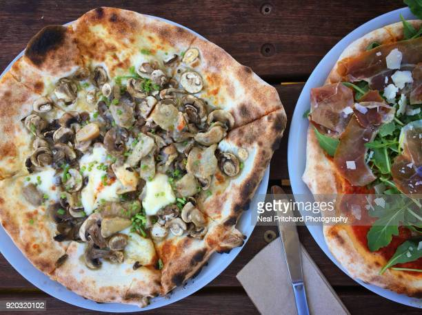 Mushroom and prosciutto homemade wood fired pizzas