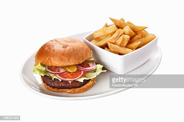 Mushroom burger with chips on plate
