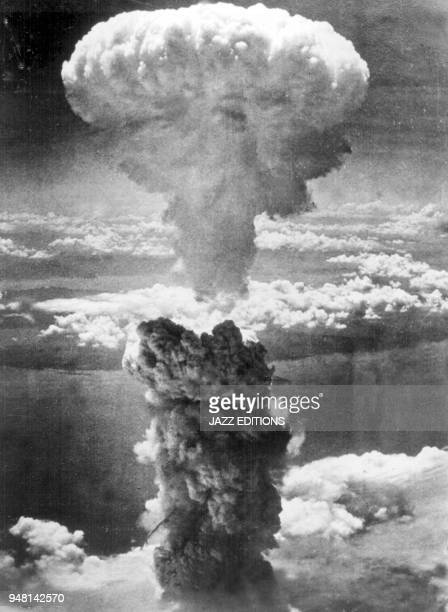 Mushroom Cloud over Nagasaki A mushroom cloud towers 20000 feet above Nagasaki Japan following a second nuclear attack by the United States on August...