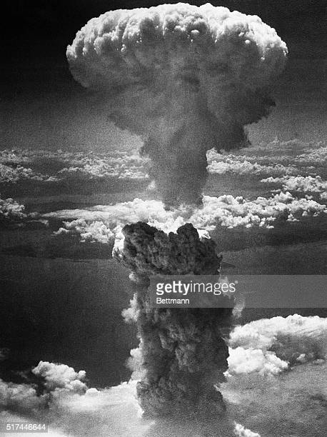 A mushroom cloud towers 20000 feet above Nagasaki Japan following a second nuclear attack by the United States on August 9 1945 The bombing which...