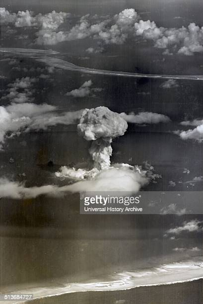 Mushroom cloud with ships below during Operation Crossroads nuclear weapons test on Bikini Atoll
