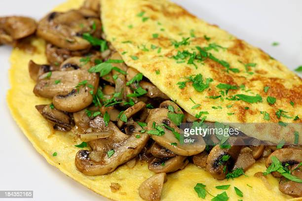 Mushroom omelet garnished with parsley on a white plate
