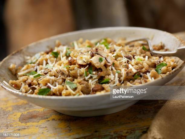 mushroom risotto - edible mushroom stock pictures, royalty-free photos & images