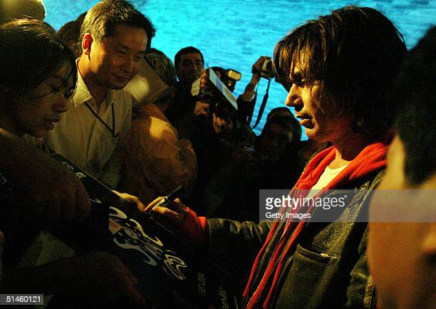 Music and light artist Jean Michel Jarre signs autographs after his concert in Tiananmen Square for the official launch of the Year of France...