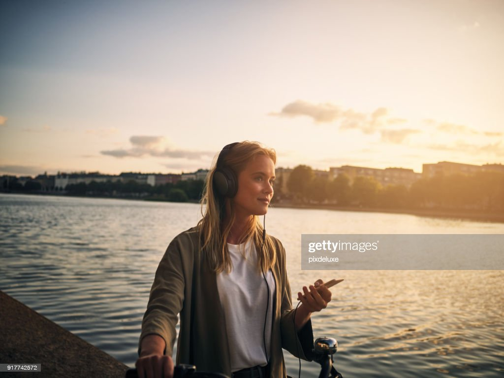 Music and this scenery is all she needs : Stock Photo