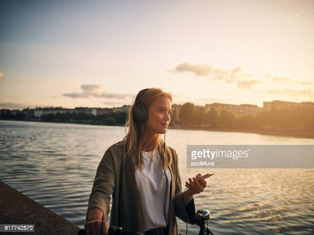 music and this scenery is all she needs - women stock pictures, royalty-free photos & images
