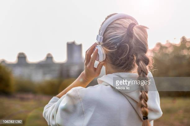music and training in park - ponytail stock pictures, royalty-free photos & images