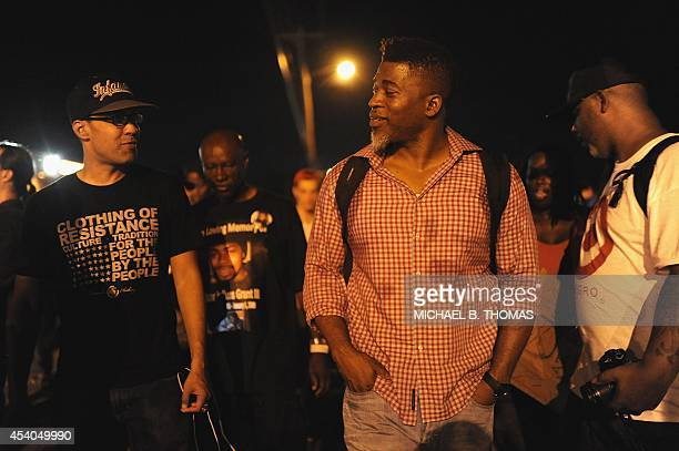 Music artist David Banner walks and interacts with demonstrators during a peaceful protest on West Florissant Avenue in Ferguson Missouri on August...