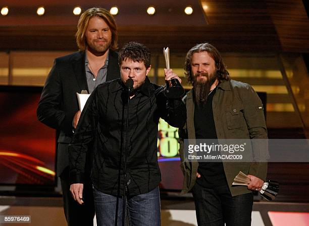 Music artist James Otto composer Lee Thomas Miller and music artist Jamey Johnson accept the award for Song of the Year during the 44th annual...