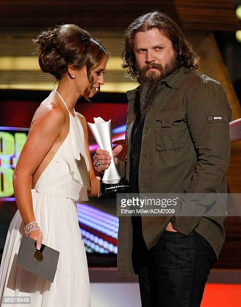 Music artist Jamey Johnson accepts the award for Song of the Year from actress Jennifer Love Hewitt during the 44th annual Academy of Country Music...