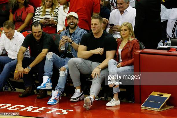 Music artist Justin Timberlake and NFL player J J Watt of the Houston Texans attend Game Five of the Western Conference Finals of the 2018 NBA...