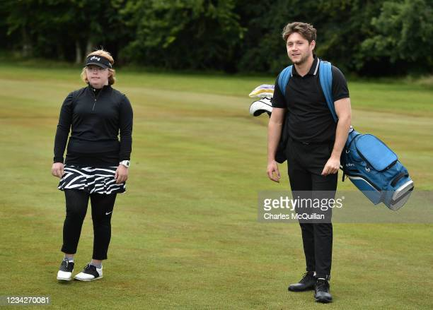 Music artist Niall Horan and Amy Bockerstette pictured during the Pro Am event at The ISPS HANDA World Invitational at on July 28, 2021 in Ballymena,...