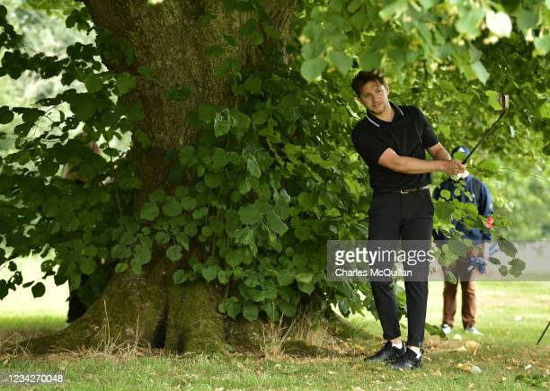 Music artist Niall Horan plays from under a tree on the 9th during the Pro Am event at The ISPS HANDA World Invitational at on July 28, 2021 in...