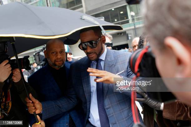 Music artist R Kelly arrives at the Circuit Court of Cook County Domestic Relations Division on March 6 2019 in Chicago Illinois Kelly denied...