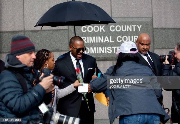 Music artist R Kelly leaves the George N Leighton Criminal Court Building after a hearing for his sex abuse case on March 22 2019 in Chicago Illinois