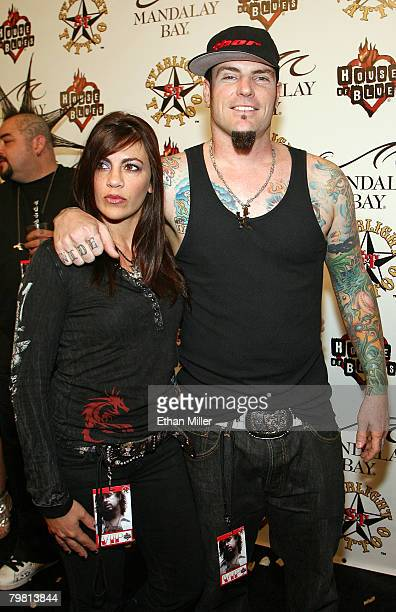 Music artist Rob Vanilla Ice Van Winkle and his wife Laura Van Winkle arrive at the grand opening of Mario Barth's Starlight Tattoo at the House of...