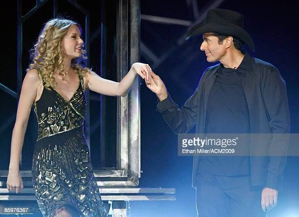 Music artist Taylor Swift and illusionist David Copperfield perform during the 44th annual Academy of Country Music Awards at the MGM Grand Garden...